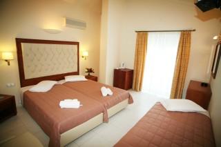 triple room la cite hotel bed